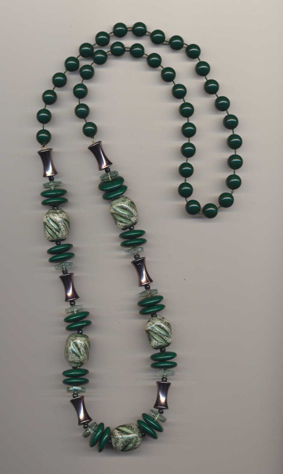Necklace made of imitation and real green plastic beads, 1970's, length 32'' 82cm.