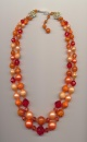 Showily vintage necklace made of plastic beads, Germany, 1960's, length inner row 18'' 46cm., outer row 20.5'' 52cm., extension chain 2'' 6cm.